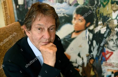 """Stock Image of Entertainment and corporate lawyer John Branca, the co-executor of Michael Jackson's estate, poses in his office next to an artwork presented to him from Sony Music commemorating the sale of 100 million copies of Michael Jackson's album """"Thriller,"""" at the law firm of Ziffren Brittenham LLP in Los Angeles"""