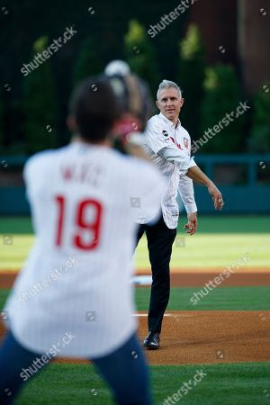 "Former Philadelphia Phillies' Chase Utley, right, throws a ceremonial first pitch to actor Rob McElhenney, creator of ""It's Always Sunny in Philadelphia"" before a baseball game between the Philadelphia Phillies and the Miami Marlins, in Philadelphia"