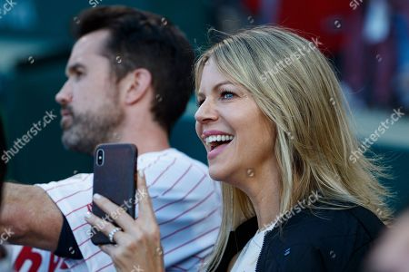 "Actress Kaitlin Olson, right, sits with her husband Rob McElhenney, creator of ""It's Always Sunny in Philadelphia"" during a retirement ceremony for former Philadelphia Phillies' Chase Utley before a baseball game between the Philadelphia Phillies and the Miami Marlins, in Philadelphia"