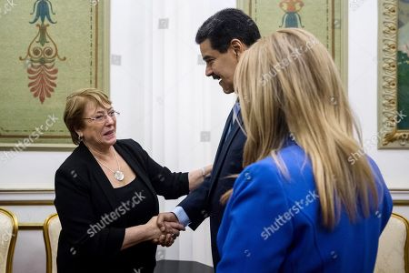 United Nations High Commissioner for Human Rights Michelle Bachelet (C-L) arrives to meet Venezuelan President Nicolas Maduro (C) and First Lady Cilia Flores (C-R) at the Miraflores Palace in Caracas, Venezuela, 21 June 2019. Maduro received Bachelet on the last day of her visit to the country.
