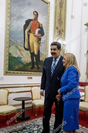 Stock Photo of Venezuelan President Nicolas Maduro (C) and First Lady Cilia Flores (C-R) wait for United Nations High Commissioner for Human Rights Michelle Bachelet (not pictured) at the Miraflores Palace in Caracas, Venezuela, 21 June 2019. Maduro received Bachelet on the last day of her visit to the country.