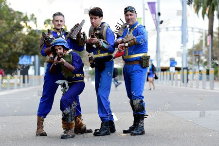 Fiona Broadway-Bennett, Finn Broadway-Bennett, Cooper Broadway-Bennett and Corey Broadway-Bennett, all dressed in cosplay as vault dwellers from the video game Fallout 4, pose for a photograph during the Sydney Supanova Comic Con and Gaming Expo 2019 at Sydney Showground Olympic Park, in Sydney New South Wales, Australia, 22 June 2019. The pop culture expo -- running in Sydney from 21 to 23 June 2019 before heading to in Perth, Adelaide, and Brisbane -- celebrates film, television, fantasy, comic books, anime, science fiction, cartoons, books and gaming.