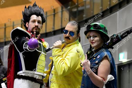 Nathan Raunjak (L), dressed in cosplay as King Vegeta from the Japanese animated series Dragon Ball Super; Joshua Edwards (C), dressed as late British singer Freddie Mercury; and Shannon Oxley (R), dressed as US science fiction movie character Tank Girl, pose for a photograph during the Sydney Supanova Comic Con and Gaming Expo 2019 at Sydney Showground Olympic Park, in Sydney New South Wales, Australia, 22 June 2019. The pop culture expo -- running in Sydney from 21 to 23 June 2019 before heading to in Perth, Adelaide, and Brisbane -- celebrates film, television, fantasy, comic books, anime, science fiction, cartoons, books and gaming.