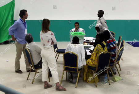 Mauritanian officials count the ballots at a voting office after the Presidential election in Nouakchott, Mauritania, 22 June 2019.  Mauritania votes on 22 June for the first round of a presidential election for a successor to President Mohamed Ould Abdel Aziz, who is stepping down after his second and final term in office.