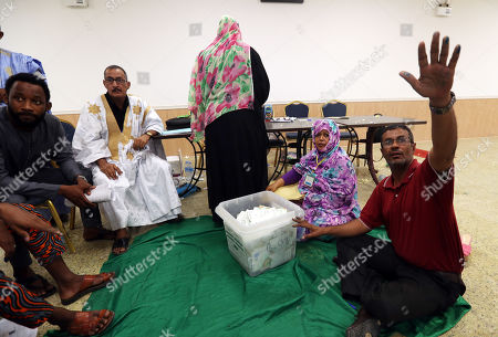 Stock Image of Mauritanian officials count ballots at a polling station during the Presidential election  in Nouakchott, Mauritania, 22 June 2019.  Mauritania votes on 22 June for the first round of a presidential election for a successor to President Mohamed Ould Abdel Aziz, who is stepping down after his second and final term in office.