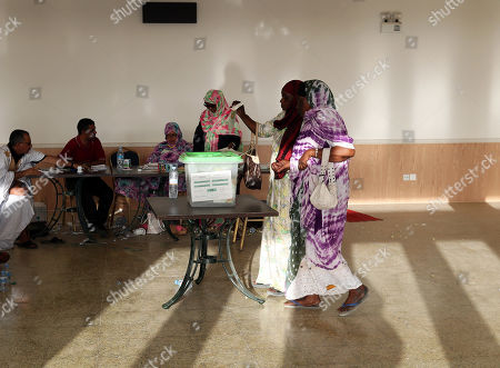 Stock Picture of A Mauritanian woman casts her ballot at a polling station during the Presidential election  in Nouakchott, Mauritania, 22 June 2019.  Mauritania votes on 22 June for the first round of a presidential election for a successor to President Mohamed Ould Abdel Aziz, who is stepping down after his second and final term in office.
