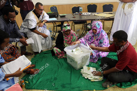 Mauritanian officials count ballots at a polling station during the Presidential election  in Nouakchott, Mauritania, 22 June 2019.  Mauritania votes on 22 June for the first round of a presidential election for a successor to President Mohamed Ould Abdel Aziz, who is stepping down after his second and final term in office.