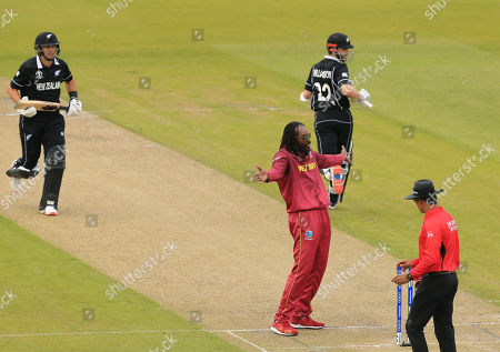 Chris Gayle of West Indies reacts as Ross Taylor and Kane Williamson of New Zealand run a single