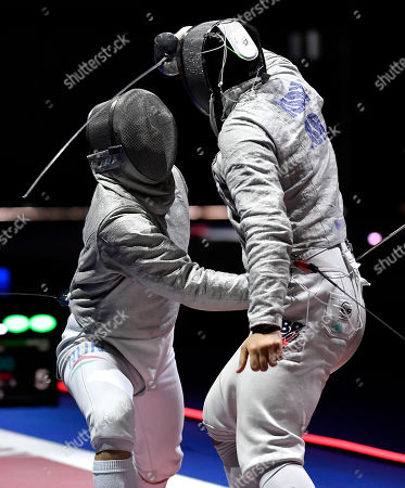 Stock Image of Csanad Gemesi of Hungary (L) and William Deary of Great Britain fight in the men's sabre team competition round of eight match of the Fencing European Championships in Duesseldorf, Germany, 22 June 2019.