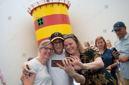 German comedian Otto Waalkes (C) takes a selfie with fans at the Kunsthalle Emden, in Emden, northern Germany, 22 June 2019. The museum is presenting artworks by Otto, who was born in Emden, from 22 June to 22 September 2019.