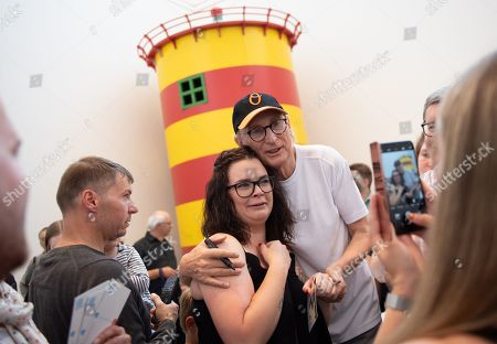 German comedian Otto Waalkes (C-R) takes a picture with a fan at the Kunsthalle Emden, in Emden, northern Germany, 22 June 2019. The museum is presenting artworks by Otto, who was born in Emden, from 22 June to 22 September 2019.