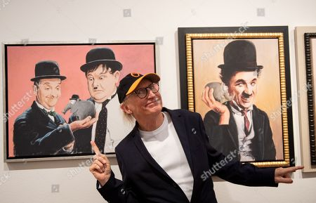 German comedian Otto Waalkes poses with some of his paintings at the Kunsthalle Emden, in Emden, northern Germany, 22 June 2019. The museum is presenting artworks by Otto, who was born in Emden, from 22 June to 22 September 2019.