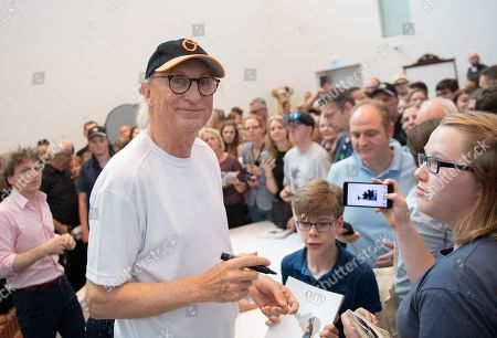 German comedian Otto Waalkes (L) signs autographs to fans at the Kunsthalle Emden, in Emden, northern Germany, 22 June 2019. The museum is presenting artworks by Otto, who was born in Emden, from 22 June to 22 September 2019.