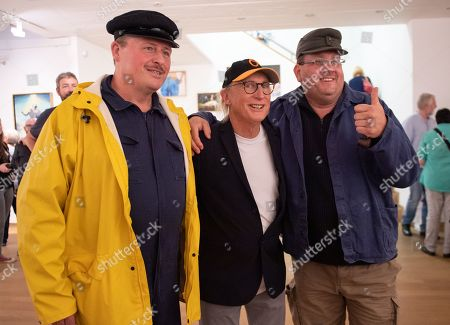 German comedian Otto Waalkes (C) poses with fans at the Kunsthalle Emden, in Emden, northern Germany, 22 June 2019. The museum is presenting artworks by Otto, who was born in Emden, from 22 June to 22 September 2019.