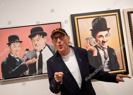 Stock Picture of German comedian Otto Waalkes poses with some of his paintings at the Kunsthalle Emden, in Emden, northern Germany, 22 June 2019. The museum is presenting an exhibition of artworks by Otto, who was born in Emden, from 22 June to 22 September 2019.