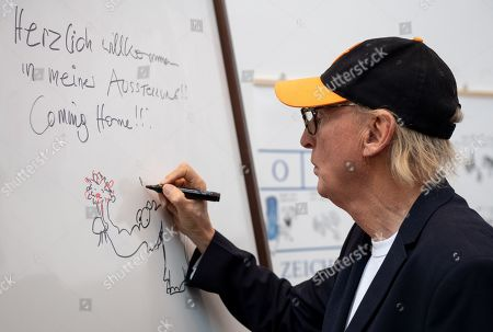 German comedian Otto Waalkes signs welcome greetings at the Kunsthalle Emden, in Emden, northern Germany, 22 June 2019. The museum is presenting an exhibition of artworks by Otto, who was born in Emden, from 22 June to 22 September 2019.