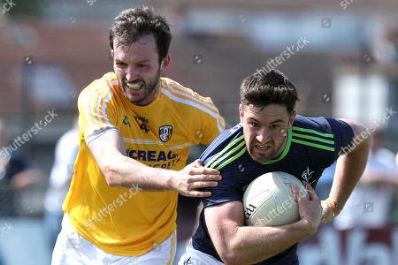 Stock Image of Antrim vs Kildare. Antrim's Patrick Gallagher and Ben McCormack of Kildare