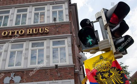 A pedestrian traffic light with the symbolic figure of German comedian Otto Waalkes in Emden, northern Germany, 22 June 2019. Waalkes was born in Emden.