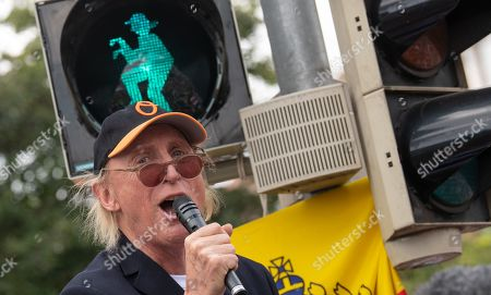 Stock Photo of Otto Waalkes celebrates the opening of a pedestrian traffic light with his symbolic figure in Emden, northern Germany, 22 June 2019. Waalkes was born in Emden.