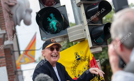 Stock Image of Otto Waalkes celebrates the opening of a pedestrian traffic light with his symbolic figure in Emden, northern Germany, 22 June 2019. Waalkes was born in Emden.