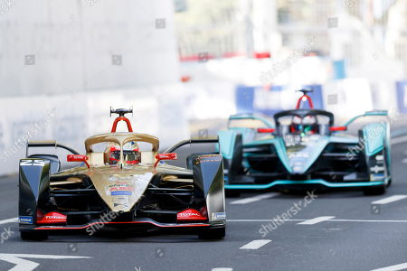 French Formula E driver Jean-Eric Vergne (L) of the DS Techeetah Formula E Team is on his way to win the Swiss E-Prix, the eleventh stage of the FIA Formula E championship in Bern, Switzerland, 22 June 2019.