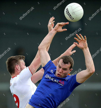 Longford vs Tyrone. Tyrone's Brian Kennedy and David McGivney of Longford contest a high ball