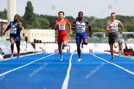 (L-R) Cameron Burrell of the USA, Xu Zhouzheng of China, Harry Aikines-Aryeetey of Britain, and Kevin Kranz of Germany in action during the 'Berlin Flies' athletics meeting at the Tempelhof airport in Berlin, Germany, 22 June 2019.
