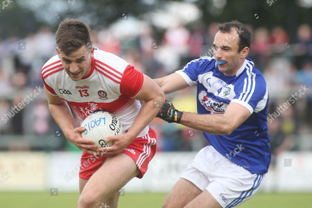 Stock Photo of Derry vs Laois. Derry's Shane McGuigan and Laois' Gareth Dillon