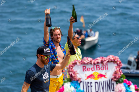 British Athlete Gary Hunt (C) (championship leader) celebrates with third placed US athlete Andy Jones (L), and second place Mexican athlete Jonathan Paredes (R) during Vila Franco do Campo Red Bull Cliff Diving World Series held at Vila Franca do Campo, Sao Miguel Island, Azores, Portugal, 22 June 2019.