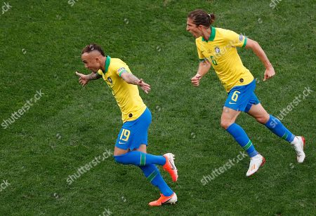 Brazil's Everton, left, celebrates scoring his side's third goal with teammate Filipe Luis during a Copa America Group A soccer match against Peru at the Arena Corinthians in Sao Paulo, Brazil