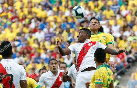 Peru's Miguel Araujo, left, and Brazil's Thiago Silva, go for a header during a Copa America Group A soccer match at the Arena Corinthians in Sao Paulo, Brazil