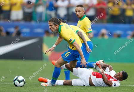 Brazil's Filipe Luis, above, and Peru's Andy Polo, compete for the ball during a Copa America Group A soccer match at the Arena Corinthians in Sao Paulo, Brazil