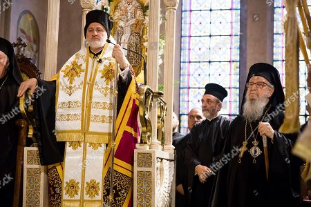 Stock Image of Archbishop Elpidophoros, left, stands at his throne on the altar next to his predecessor, former Archbishop Demetrios of America, right, inside the Archdiocesan Cathedral of the Holy Trinity during Elpidophoros' enthronement ceremony as the new archbishop for America, in New York. Elpidophoros Lambriniadis, 61, a native of Istanbul and a longtime theology professor in Greece, was enthroned as archbishop in an elaborate ceremony at the Cathedral