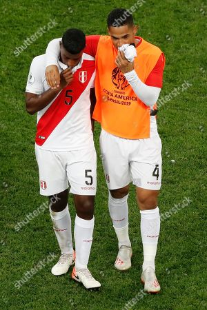 Stock Image of Peru's Miguel Araujo, left and Anderson Santamaria leave the field after their 0-5 lost against Brazil during a Copa America Group A soccer match at the Arena Corinthians in Sao Paulo, Brazil