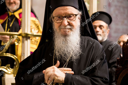 Former Archbishop Demetrios of America holds his hand over his heart as churchgoers applaud him for his 20 years of service as archbishop of America for the Greek Orthodox Church in the Archdiocesan Cathedral of the Holy Trinity, in New York. Elpidophoros Lambriniadis, 61, a native of Istanbul and a longtime theology professor in Greece, was enthroned as archbishop in an elaborate ceremony at the Cathedral of the Holy Trinity in Manhattan. Many Greek Americans from across the U.S. came to New York for the event