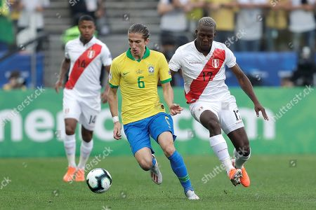 Brazilian Filipe Luis (L) vies for the ball with Peruvian Luis Advincula during the Copa America 2019 Group A soccer match between Peru and Brazil, at Arena Corinthians Stadium in Sao Paulo, Brazil, 22 June 2019.