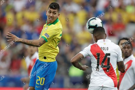 Stock Picture of Brazil's Roberto Firmino (L) vies for the ball with Peru's Andy Polo during the Copa America 2019 Group A soccer match between Peru and Brazil, at Arena Corinthians Stadium in Sao Paulo, Brazil, 22 June 2019.