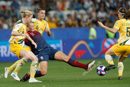 Norway's Lisa-Marie Karlseng Utland, second from left, tries to reach the ball as in action with Australia's Clare Polkinghorne, left, Australia's Chloe Logarzo, second from right, and Australia's Laura Alleway, right, during the Women's World Cup round of 16 soccer match between Norway and Australia at the Stade de Nice in Nice, France