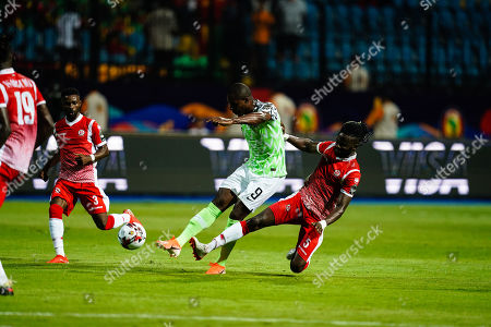 odion Jude Ighalo of Nigeria shooting on goal in front of Gael Bigirimana of Burundi during the African Cup of Nations match between Nigeria and Burundi at the Alexandria Stadium in Alexandia, Egypt