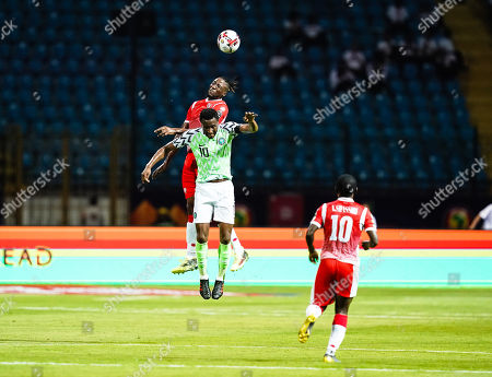 Stock Photo of Mikel John Obi of Nigeria and Nsabiyumva FreÌÂ?deÌÂ?ric of Burundi challenging for the ball during the African Cup of Nations match between Nigeria and Burundi at the Alexandria Stadium in Alexandia, Egypt