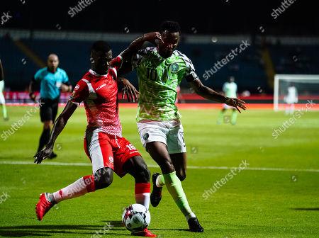 Stock Image of Mikel John Obi of Nigeria and Saido Berahino of Burundi during the African Cup of Nations match between Nigeria and Burundi at the Alexandria Stadium in Alexandia, Egypt