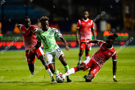Samuel Chimerenka Chukwueze of Nigeria going past Gael Bigirimana of Burundi during the African Cup of Nations match between Nigeria and Burundi at the Alexandria Stadium in Alexandia, Egypt