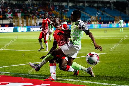 David Nshimirimana of Burundi tackling Ahmed Musa of Nigeria during the African Cup of Nations match between Nigeria and Burundi at the Alexandria Stadium in Alexandia, Egypt