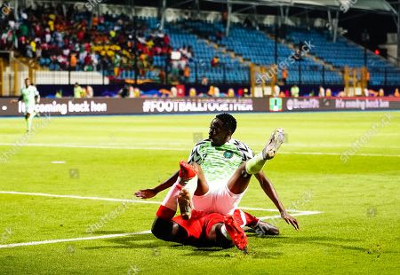 Ahmed Musa of Nigeria falling during the African Cup of Nations match between Nigeria and Burundi at the Alexandria Stadium in Alexandia, Egypt