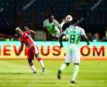 Kenneth Josiah omeruo of Nigeria heading the ball away during the African Cup of Nations match between Nigeria and Burundi at the Alexandria Stadium in Alexandia, Egypt