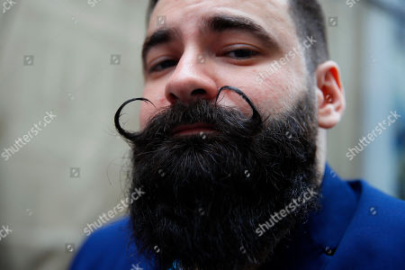 Freddy Gimeno from Ileana Cabra de France poses during the France's Beard Championship to compete in one of the dozen categories of beard and moustache styles, in Paris, Saturday, June 22