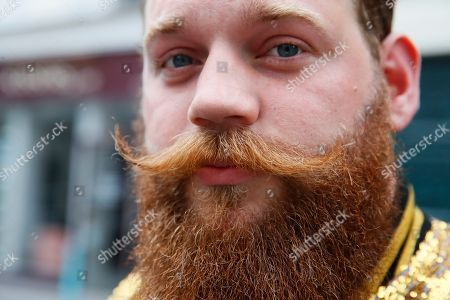 Tanguy Rousseau from Ileana Cabra de France region, in the category Verdi Beard poses during the France's Beard Championship to compete in one of the dozen categories of beard and moustache styles, in Paris, Saturday, June 22