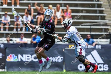 Chrome's Jordan MacIntosh advances on Redwoods' Tyler Dunn during a Premier Lacrosse League game on in Baltimore