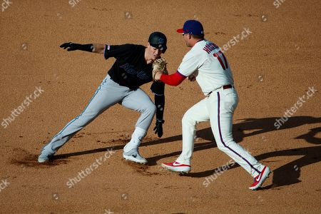 Rhys Hoskins, Brian Anderson. Miami Marlins' Brian Anderson, left, is caught in a rundown by Philadelphia Phillies first baseman Rhys Hoskins after hitting an RBI-single and trying to advance to second during the eighth inning of a baseball game, in Philadelphia