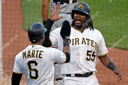 Josh Bell, Starling Marte. Pittsburgh Pirates' Josh Bell (55) celebrates with Starling Marte (6) after they scored on an RBI-single by Adam Frazier off San Diego Padres relief pitcher Craig Stammen during the eighth inning of a baseball game in Pittsburgh